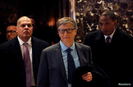 Businessman Bill Gates exits through the lobby at Trump Tower in Manhattan, New York City, Dec. 13, 2016.