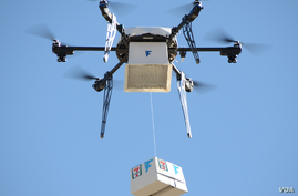 A Flirtey drone makes a delivery in Nevada. The company claims it is the first to establish routine drone delivery services. (Flirtey)