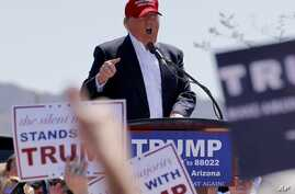 Republican presidential candidate Donald Trump speaks during a campaign rally in Fountain Hills, Arizona, March 19, 2016.