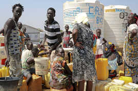Residents of the Mangateen camp for the internally-displaced line up to get water from a borehole, on the outskirts of the capital Juba, South Sudan, Jan. 22, 2019.