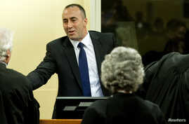 Kosovo's former Prime Minister and former commander of the Kosovo Liberation Army Ramush Haradinaj smiles during the verdict reading in his retrial at the International Criminal Tribunal for the former Yugoslavia in The Hague November 29, 2012.