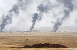 Smoke rises from clashes with Islamic State militants on the southeast of Mosul, Iraq, Aug. 14, 2016.