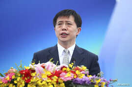 FILE - Ji Wenlin, then mayor of Haikou city, speaks at the opening ceremony of a yatch race in Haikou, Hainan province.