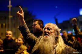 Protesters shout slogans during demonstrations against an agreement that would ensure the wider official use of the Albanian language, in Skopje, Macedonia, March 6, 2017.