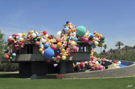 The David and Gladys Wright House in Phoenix, Arizona, is shown covered with balloons, June 8, 2017.