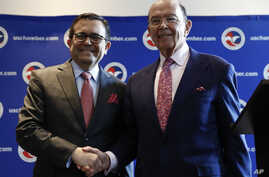 Commerce Secretary Wilbur Ross and Mexico Secretary of the Economy Ildefonso Guajardo Villarreal shake hands after a news conference at the U.S. Chamber of Commerce in Washington, June 6, about Mexico sugar exports.