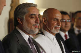 Afghanistan's rival presidential candidates Abdullah Abdullah, left, and Ashraf Ghani announce an audit plan in Kabul on July 12, 2014.
