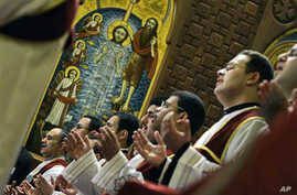 Egyptian Coptic priests pray during Christmas mass at Saint Mark Coptic Orthodox Cathedral in Cairo (file photo)