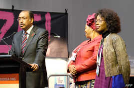 UNAIDS Executive Director Michel Sidibe (L) from Mali speaks at the opening of the Global Village on the 2nd day of the 20th International AIDS Conference at the Melbourne Convention and Exhibition Centre (MCEC) in Melbourne, July 21, 2014.