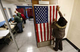 Election workers set up voting booths at Memorial Elementary School in Little Ferry, N.J., Nov. 6, 2012.