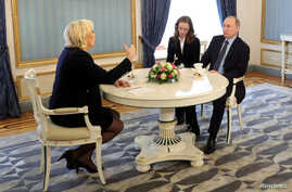 Russian President Vladimir Putin meets with Marine Le Pen, French National Front (FN) political party leader and candidate for the French 2017 presidential election, in Moscow, Russia, March 24, 2017.
