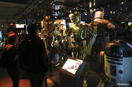 """FILE - Characters from the """"Star Wars"""" film series are seen during a press preview for the exhibit """"Star Wars Identities"""" at the MAK museum in Vienna, Austria, Dec. 17, 2015. """"Star Wars"""" filmmaker George Lucas has chosen Los Angeles to host his new m"""