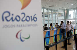 People buy Olympic tickets at a shopping mall in Rio de Janeiro, Brazil, June 20, 2016.