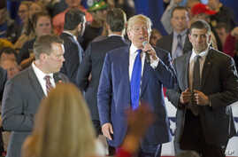 Republican presidential candidate Donald Trump walks through the buffer as he mixes with supporters mid-speech during a campaign stop at the Savannah Center, March 13, 2016, in West Chester, Ohio.