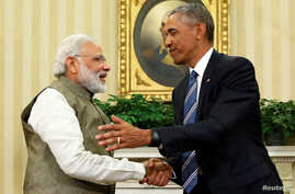 U.S. President Barack Obama (R) shakes hands with India's Prime Minister Narendra Modi after their remarks to reporters following a meeting in the Oval Office at the White House in Washington, D.C., June 7, 2016.