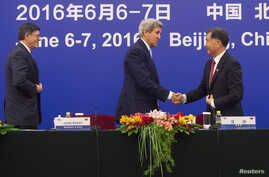 U.S. Secretary of State John Kerry shakes hands with Chinese Vice Premier Wang Yang during the US - China Strategic and Economic Dialogue at the Great Hall of the People in Beijing, June 7, 2016.