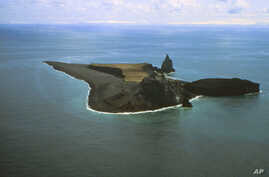 FILE - An aerial photo provided by Alaska Volcano Observatory/U.S. Geological Survey shows the Bogoslof Island looking south.