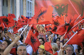 Supporters of the governing Socialist Party (PS) wave Albanian national flags during the closing electoral rally in capital Tirana, Albania, June 22, 2017. Albania holds parliamentary elections Sunday.