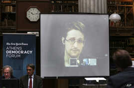 National Security Agency leaker Edward Snowden speaks via video link during the Athens Democracy Forum, organised by the New York Times, at the National Library in Athens on Sept. 16, 2016.