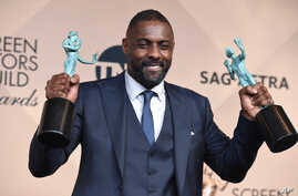 "Idris Elba poses in the press room with the award for outstanding male actor in a supporting role for ""Beasts of No Nation"" and the award for outstanding male actor in a TV movie or miniseries for ""Luther"" at the 22nd annual Screen Actors Gui..."