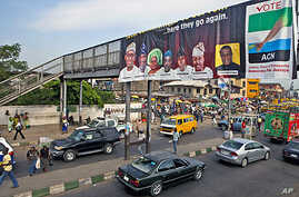 An election banner hangs on a pedestrian bridge in Mushin Neighborhood in Nigeria's commercial capital, Lagos, March 23, 2011