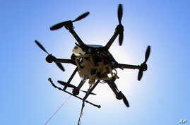 FILE - A drone is pictured at a testing site in Lincoln, Neb., Sept. 6, 2013. An experimental study in Sweden suggests drones equipped with heart defibrillators could help with response times for out-of-hospital cardiac arrest.