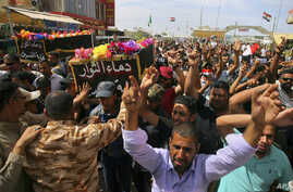 Mourners carry the coffins of two people, killed in protests at Baghdad's International Zone on Friday, during their funeral procession at the holy shrine of Imam Ali, in Najaf, 160 kilometers south of Baghdad, Iraq, May 21, 2016.