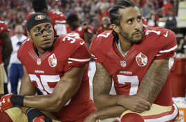 San Francisco 49ers safety Eric Reid (35) and quarterback Colin Kaepernick (7) kneel during the national anthem before an NFL football game against the Los Angeles Rams in Santa Clara, California, Sept. 12, 2016.