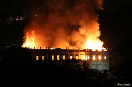 A fire blazes at the National Museum of Brazil in Rio de Janeiro, Brazil, Sept. 2, 2018 in this picture obtained from social media.