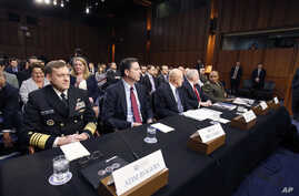 FILE - National Security Agency Director Admiral Michael Rogers (L) and FBI Director James Comey, testify before a congressional panel on Capitol Hill in Washington, Feb. 9, 2016.