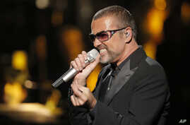 FILE - In this Sept. 9, 2012 photo, George Michael sings during a concert to raise money for the AIDS charity Sidaction, in Paris, France.