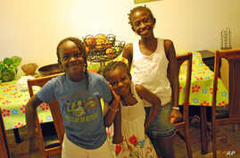 The mother of sisters Sainey, Innakumba and Victoria (from left) sought asylum in the United States to keep her daughters from being subjected to female mutilation.
