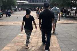 """After fleeing Honduras and entering the United States legally, """"Capi"""" and his daughter """"Jamie""""  were separated for four months. (Photo courtesy of Christine M. Fox)"""