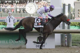 Mario Guitierrez rides Nyquist to victory in the 142nd running of the Kentucky Derby horse race at Churchill Downs in Louisville, Ky., May 7, 2016.