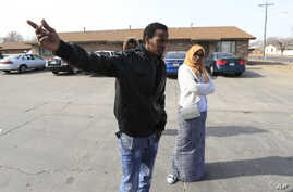 Ifrah Ahmed, right, and Mursal Naleye, left, stand outside the apartments threatened in a bomb plot in Garden City, Kan., Feb. 3, 2017.