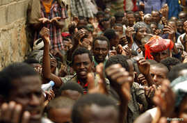Ethiopian migrants, stranded on Yemen's border with Saudi Arabia, recite prayers appealing for evacuation to their home country from the western Yemeni town of Haradh, March 30, 2012.