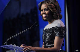 FILE - U.S. first lady Michelle Obama speaks in Washington, March 14, 2014.