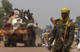 A Chadian soldier, part of the African Union (AU) peacekeeping mission in the Central African Republic, keeps guard during the beginning of a road repatriation to Chad in the capital Bangui, Jan. 22, 2014.