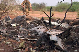 This photo provided by the French army shows soldiers at the site of the Air Algerie plane crash in Mali, July 25, 2014.