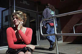 A woman who only gave her first name, Ally, said it was her first time applying for food stamps - the Supplemental Nutrition Assistance Program (SNAP) - at a city building in El Cajon, Calif., May 2010 (file photo)