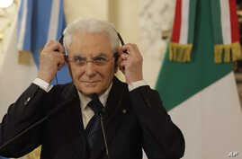 Italy's President Sergio Mattarella puts on headphone during a meeting with Argentina's President Mauricio Macri at the government house in Buenos Aires, Argentina, May 8, 2017.