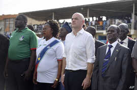 FIFA's new president, Gianni Infantino, at center-right, stands with South Sudan's Vice President James Wani Igga, right, before a match between South Sudan and Benin, in Juba, March 23, 2016. Infantino came to help open the South Sudan Football Asso