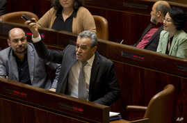FILE - Jamal Zahalka, an Israeli-Arab lawmaker, yells during a session in the Knesset, Israel's parliament, in Jerusalem, Feb. 8, 2016.
