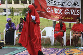 """A member of the Abuja """"Bring Back Our Girls"""" protest group addresses a sit-in demonstration organized by the group at the Unity Fountain in Abuja, Nigeria, June 23, 2014."""