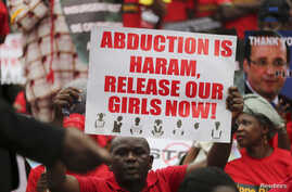 FILE: A protester calls for the release of schoolgirls abducted in April by Boko Haram.