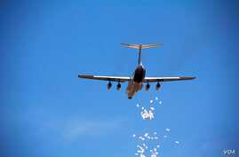 A World Food Programme airdrop over Yida refugee camp in South Sudan in December 2011.