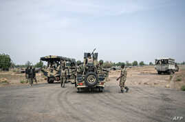 FILE - Soldiers of the 7th Division of the Nigerian Army meet at a cross road in Damboa, Borno State northeast Nigeria on March 25, 2016.