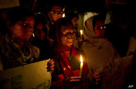 India Acid Attack: FILE - In this Dec. 16, 2014 file photo, acid attack survivors participate in a candlelit vigil protesting violence against women as they mark the second anniversary of the deadly gang rape of a student on a bus, in New Delhi, Indi
