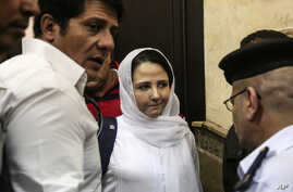 Aya Hijazi, center, a dual U.S.-Egyptian citizen, is acquitted by an Egyptian court after nearly three years of detention over accusations related to running a foundation dedicated to helping street children, Cairo, April 16, 2017.