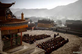 Monks gather to pray at the Labrang monastery prior Tibetan New Year in Xiahe county, Gansu Province February 21, 2012.
